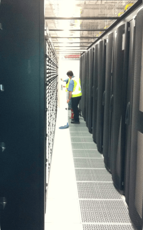 Data centre above-floor cleaning with mop